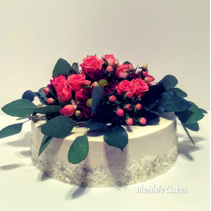 buttercream cake with live flowers